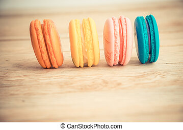 Colorful macaron on wooden floor in Vintage style 2