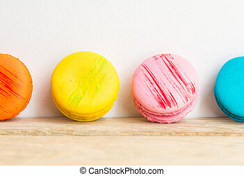 Colorful macaron with white background on wooden floor 2