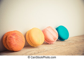 Colorful macaron with white background on wooden floor in Vintag