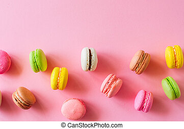 Colorful macarons cookies, top view flat lay, food background co