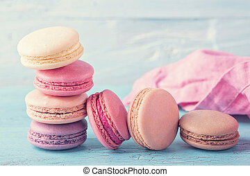 Colorful macarons on a blue wooden background