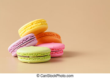 colorful macaroons on beige background