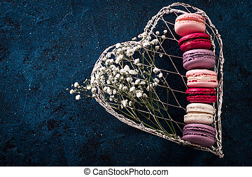 colorful macaroons on blue background,top view ,Holiday food concept
