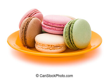 colorful macaroons on plate with clipping path, side view