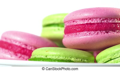 Colorful macaroons rotating, horizontal view. Cooking, food...