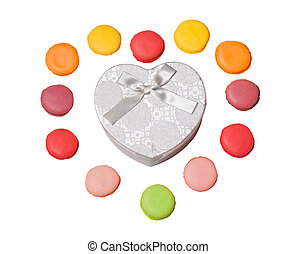 Colorful macaroons with heart shape gift box on white background