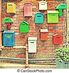 Colorful mailboxes with vintage effect.