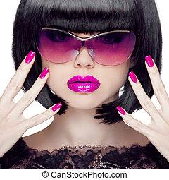 Colorful Make up. Closeup portrait. Purple sexy lips. Manicured polish nails. Luxury Brunette Woman wearing in Fashion Sunglasses. Black short hair style.