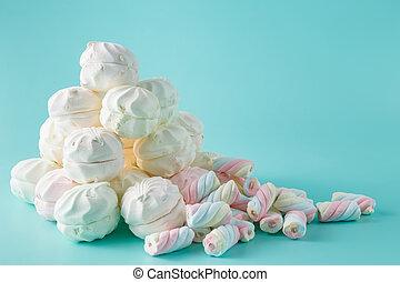 Colorful marshmallow heap on aquamarine background