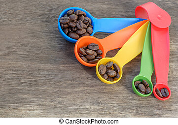 colorful measuring spoon with coffee
