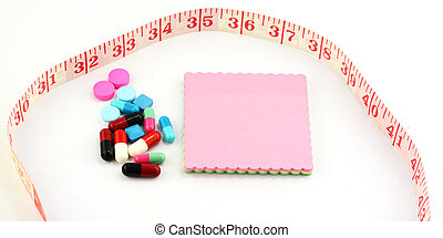 Colorful medical pills and capsules on white background.