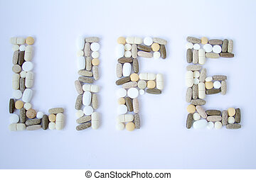 Colorful medical pills loose on a white background. - The...