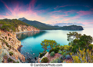 Colorful Mediterranean seascape in Turkey. Spring sunrise in a small bay near the Tekirova village, District of Kemer, Antalya Province. Artistic style post processed photo.
