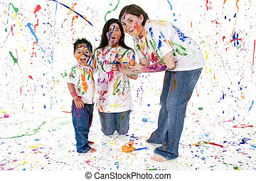 Colorful Mess - Little brother and big sisters making huge...