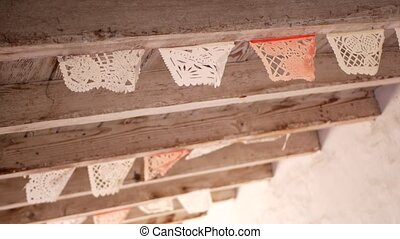 Colorful mexican perforated papel picado banner, festival colourful paper garland. Multi colored hispanic folk carved tissue flags, holiday or carnival. Authentic fiesta decoration in Latin America.