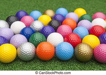 Colorful Miniature Golf Balls on Grass