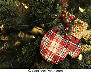 Colorful Mitten Christmas ornament on Christmas Tree with copy space