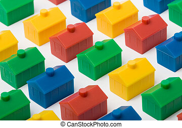 Colorful model houses set against a white background