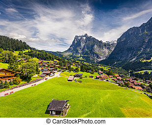 Colorful morning view of Grindelwald village valley from cableway.