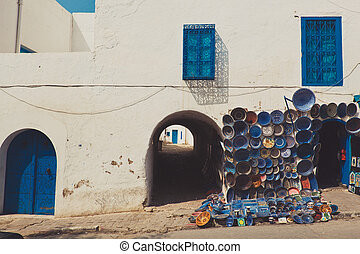 Colorful Moroccan faience pottery dishes on display in the street