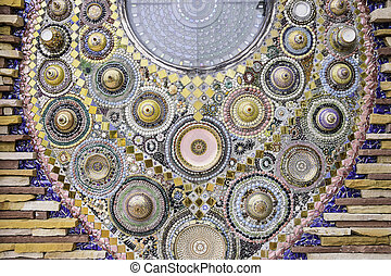 mosaic wall made from glass, pebble and ceramic bowl