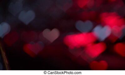 Colorful multicolored lights heart shaped motion background bokeh