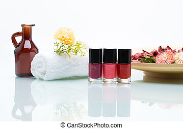 Colorful nail polishes and Dried Flowers