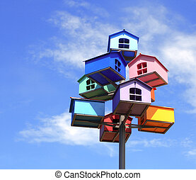 Colorful nesting boxes on blue sky