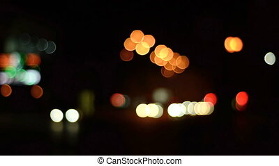 colorful night lights and glare car passing of a blurred...