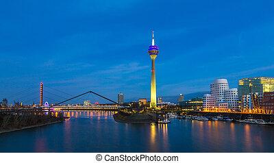 Colorful night scene of Rhein river at night in Dusseldorf....