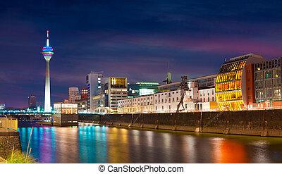 Colorful night scene of Rhein river at night in Dusseldorf.