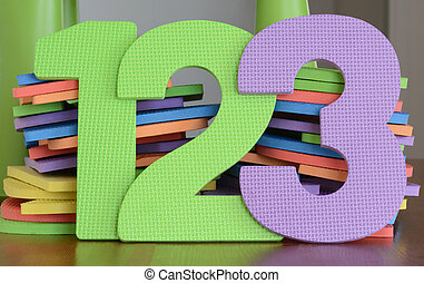 Colorful numbers 1, 2, 3, in a row of flat foam number toys