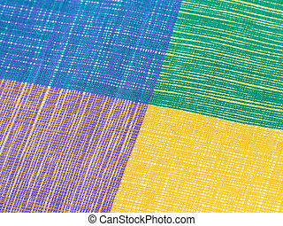 Colorful of fabric texture background for wallpaper. Closed up blue, yellow, purple and green fabric texture.
