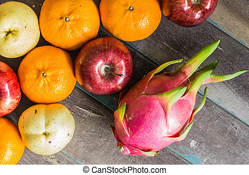 Colorful of fruits on wooden