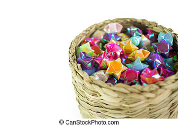 colorful of paper fold christmas stars in the wood basket
