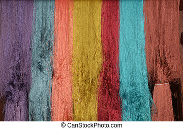 colorful of raw multicolor silk thread background