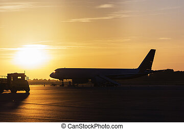 Colorful of sunset in the airport with aeroplane wing, Business and transportation concept.
