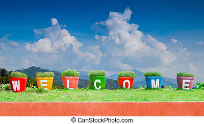Colorful of the Welcome on blue sky background