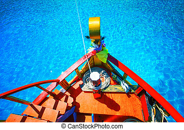 colorful of wood boat against beautiful clear blue sea water wit
