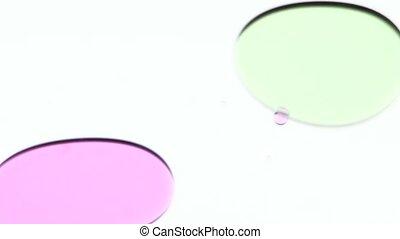 Colorful oil bubbles. White. Close up