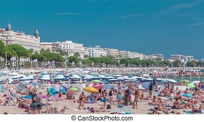 Colorful old town and beach in Cannes timelapse on french...