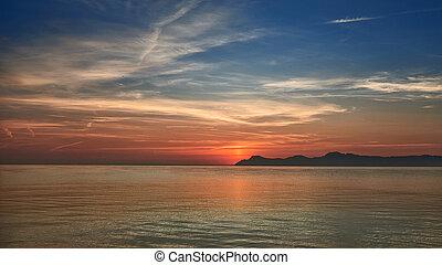 Colorful orange marine sunset over a calm ocean