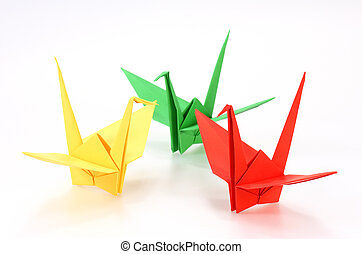 colorful Origami cranes on white background