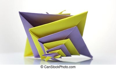 Colorful origami toy. Origami figure isolated on white...