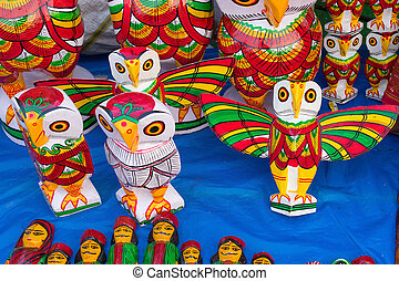Colorful owls made of wood - Handicrafts on display