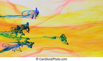 Colorful paint in dynamic flow. Blue jet of ink on yellow...