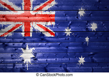 painted australian flag on a wooden texture