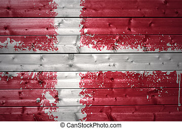 colorful painted danish flag on a wooden texture
