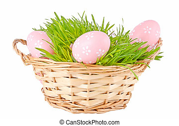 Colorful painted easter eggs in basket on the white background