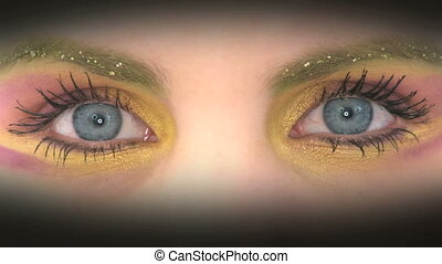 Colorful painted eyes - Close-up of colorful rouged eyes